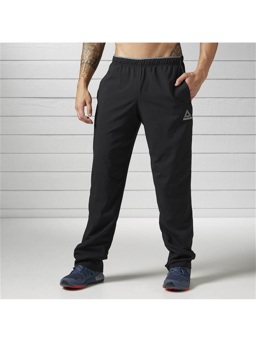 Брюки Reebok Брюки WOR WOVEN PANT      BLACK брюки nike брюки training df stretch woven pant